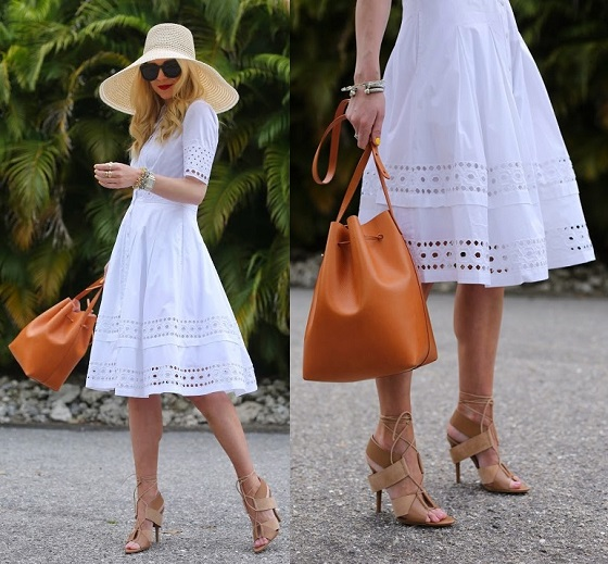 vestido de renda branco com bolsa saco bucket bag e chapéu de palha