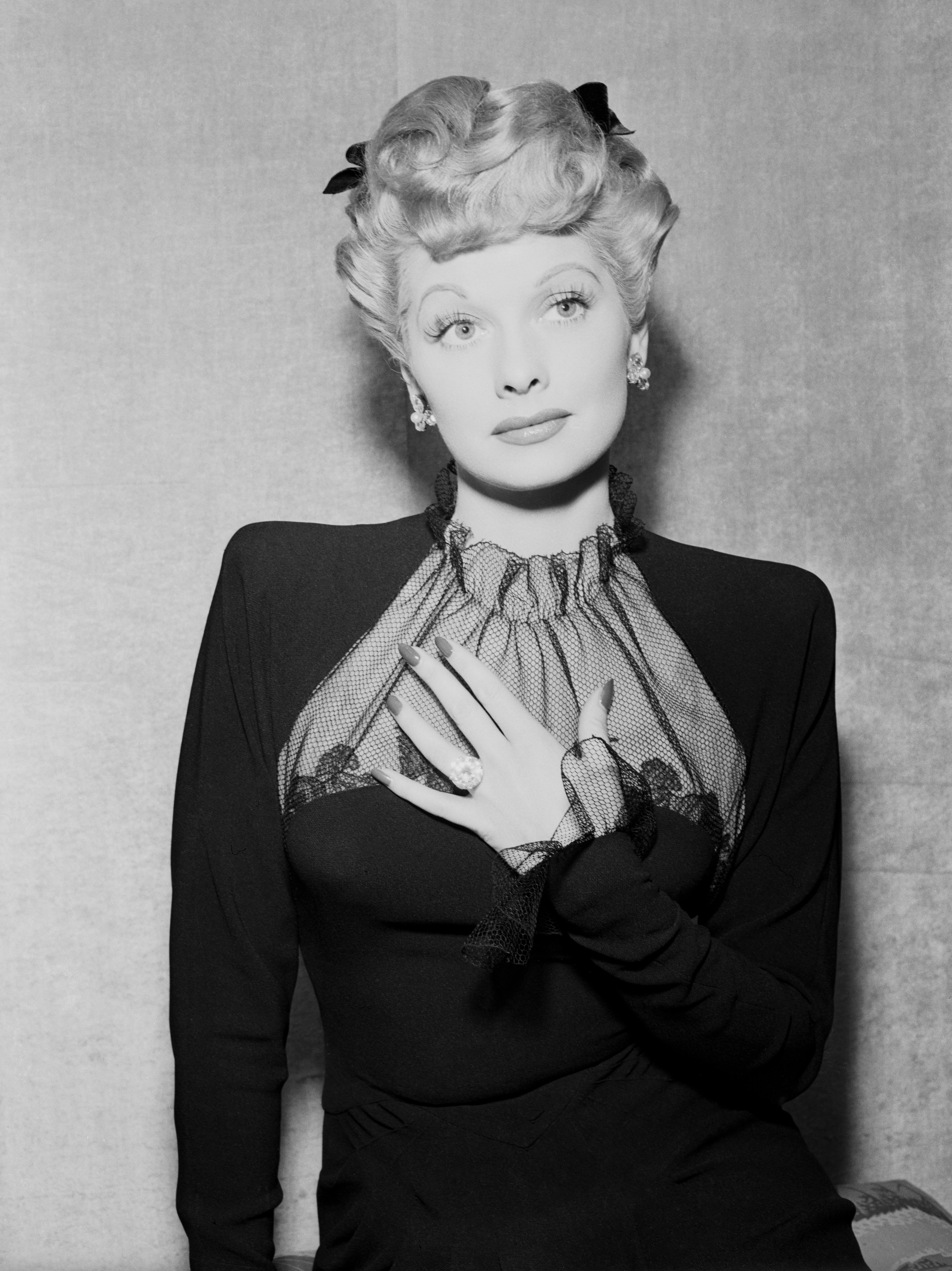 """08 Oct 1943 --- Original caption: Lucille Ball, who was currently starring in MGM's Meet The People,"""" was married to Desi Arnaz, who was later in the Army. With marriages then expected to reach an all time high of 2,000,000 in 1943, public interest in engagement and marriage rings was correspondingly high. Lucille Ball is shown wearing the ring chosen by herself as a Hollywood bride to be. --- Image by © Bettmann/CORBIS"""