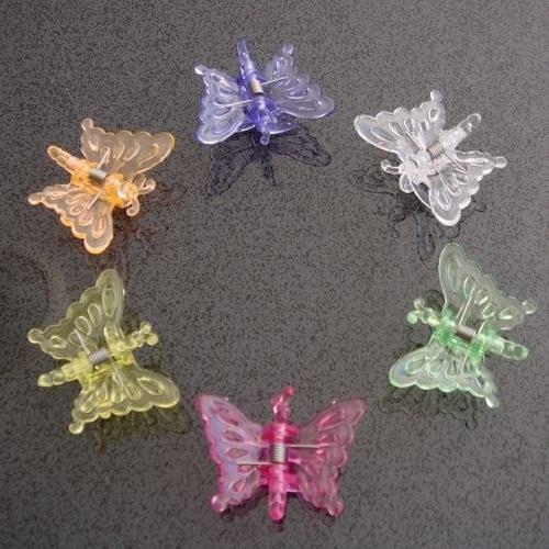 tendência de moda anos 90 borboleta para cabelo
