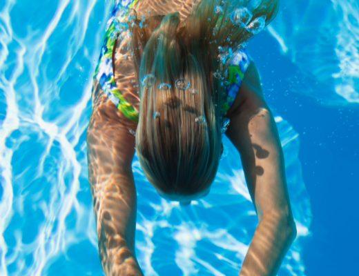 Swimming pool, woman swimming under water