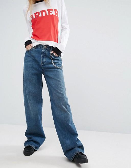 calça jeans estilo anos 90