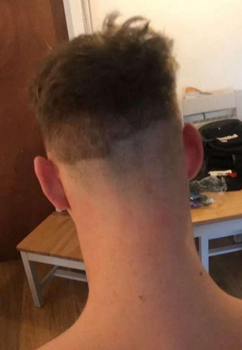 mulher-cortando-cabelo-do-namorado